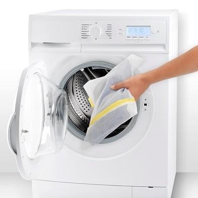 Как правильно стирать вручную и в стиральной машие шторы нити